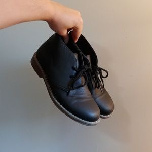 Place uniform lace up boots